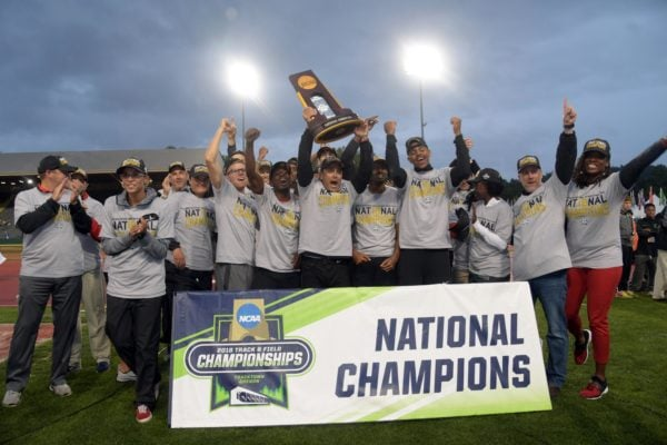 Jun 8, 2018; Eugene, OR, USA; Members of the Georgia Bulldogs men's team and coach Petros Kyprianou pose after winning the team title during the NCAA Track and Field championships at Hayward Field. Mandatory Credit: Kirby Lee-USA TODAY Sports