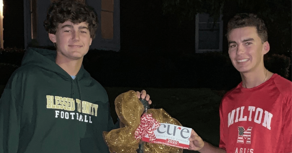 Brothers Fight Pediatric Cancer with Gold Bows